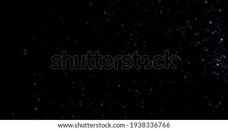 Flying dust particles on a black background Foto stock ©