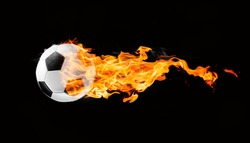 Flying football or soccer ball on fire. Isolated on black background.