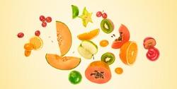 Flying fruits healthy summer color background. Papaya, orange, kiwi, melon. Levitation, falling fly fruit. Tropical creative concept. Colorful fruity summertime vivid design