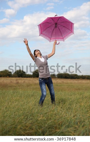 Flying girl with umbrella in the sky