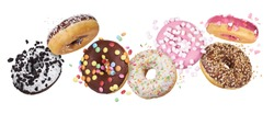 flying glazed round doughnuts. Mix of multicolored sweet donuts with sprinkles on white background