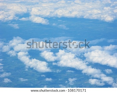 Flying high above the clouds - stock photo
