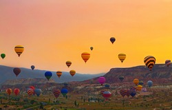 Flying hot air balloon in sunrise Cappadocia. Goreme National Park Turkey.