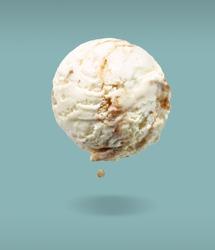 flying ice cream scoop on blue background