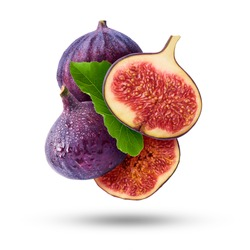 Flying in air fresh ripe whole and cut Figs  isolated on white background. High resolution image