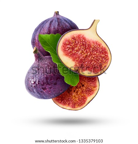 Flying in air fresh ripe whole and cut Figs  isolated on white background. High resolution image #1335379103