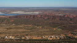 Flying into Mt Isa with Queensland landscape view of Mountains and skyline. Aerial view of Mount Isa during a dry winter in June 2019