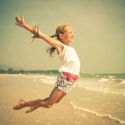flying jump beach girl on blue sea shore in summer vacation