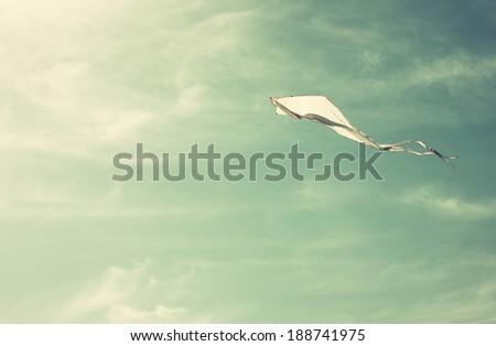 flying kite in the sky. retro...