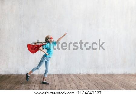 Flying little hero in studio