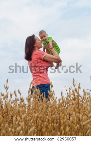 flying newborn holding by mother at the nature