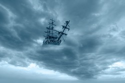 Flying old ship in the clouds