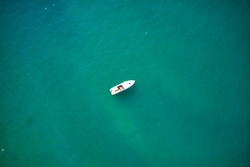Flying on a drone, the view of the boats in motion, Lake Garda. Italy.