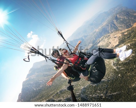 Flying on a paraglider. View of the coast from a height.