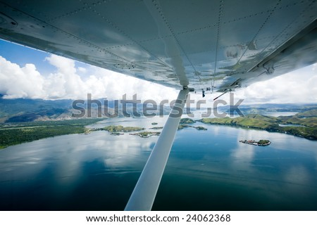 Flying over lake Sentani, Papua Indonesia - stock photo