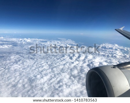 Flying over Rome, over the clouds #1410783563