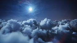 Flying over the deep night timelapse clouds with moon light. Seamlessly looped animation. Flight through moving cloudscape with beautiful moon. Perfect for cinema, background, digital composition.