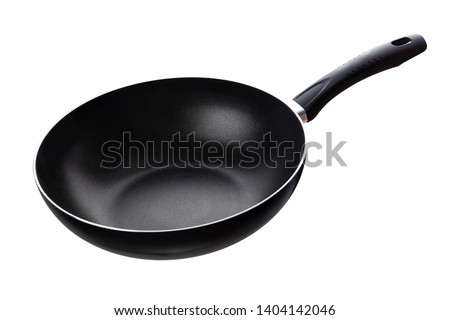 Photo of  Flying pan isolated on white background
