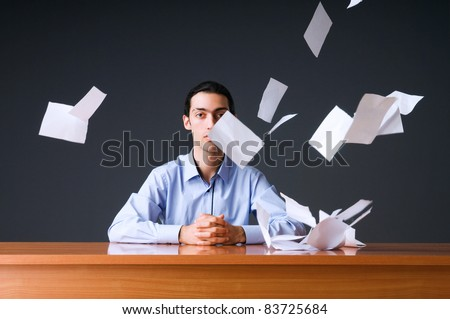 Flying paper and businessman in office