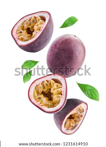 Flying passion fruits isolated on white background. Clipping path