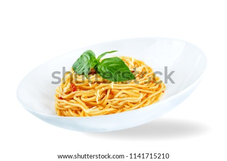 Stock Photo Flying Pasta with Marinara sauce and fresh Basil isolated. toning. selective focus