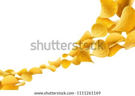 Flying potato chips, isolated on white background
