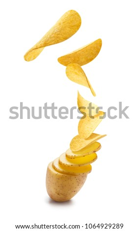 Flying potato slices turning into chips, isolated on white background