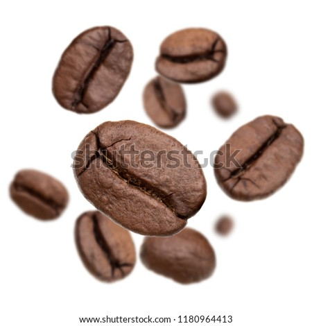 Flying roasted coffee beans isolated in white background cutout. Food background. #1180964413