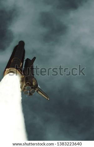 Flying rocket. Rocket launch. The elements of this image furnished by NASA. #1383223640
