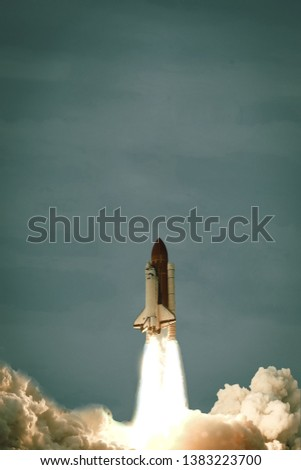 Flying rocket. Rocket launch. The elements of this image furnished by NASA. #1383223700