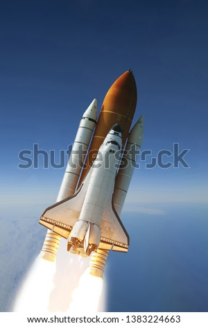 Flying rocket. Rocket launch. The elements of this image furnished by NASA.