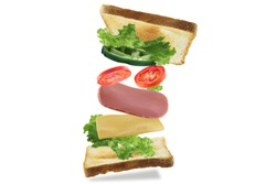 Flying sandwich in the air to show the ingredients with toast bread,bologna,cheese,bell pepper,tomato and lettuce isolated on white background.With clipping path.