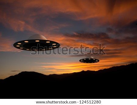 Flying saucer UFOs at sunset - alien space craft