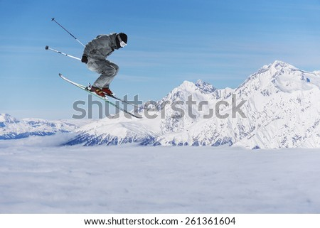Flying skier on mountains, extreme sport #261361604