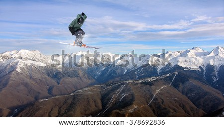 Flying skier on mountains. Extreme sport. #378692836