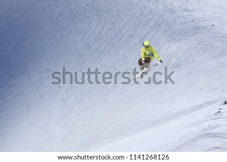 Flying skier on mountains. Extreme winter sport. #1141268126