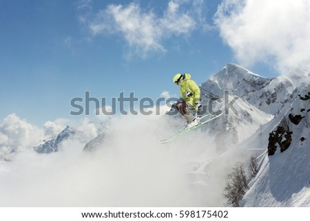 Flying skier on mountains. Extreme winter sport. #598175402