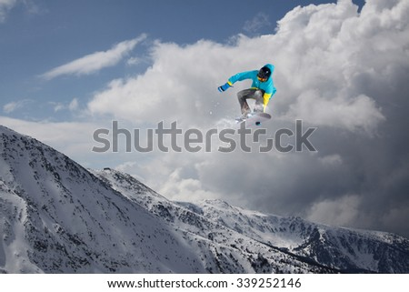 Flying snowboarder on mountains, extreme sport #339252146