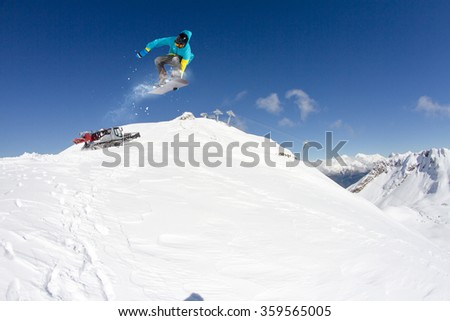 Flying snowboarder on mountains. Extreme sport. #359565005