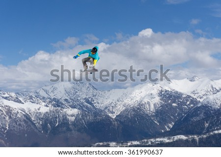 Flying snowboarder on mountains. Extreme sport. #361990637