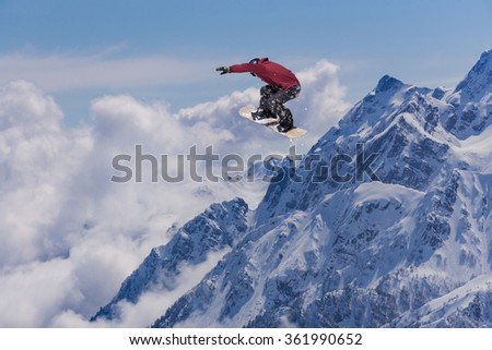 Flying snowboarder on mountains. Extreme sport. #361990652