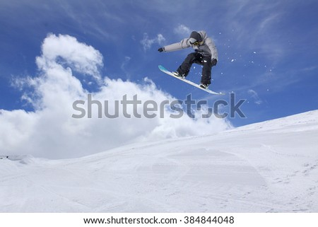 Flying snowboarder on mountains. Extreme sport. #384844048
