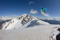 Flying snowboarder on mountains, extreme winter sport