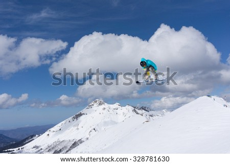 Flying snowboarder on mountains, extreme winter sport #328781630