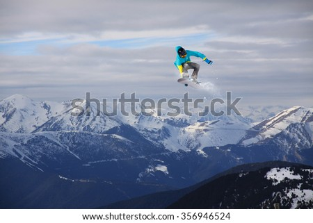 Flying snowboarder on mountains. Extreme winter sport. #356946524