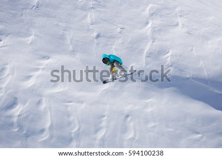 Flying snowboarder on mountains. Extreme winter sport. #594100238