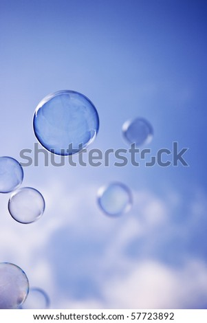 Flying soap bubbles in the air