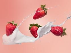 flying strawberries with milk or yogurt splash