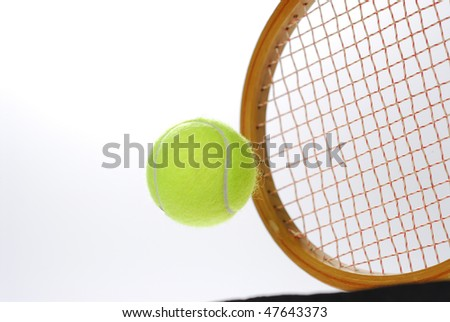 flying tennis ball and racket - stock photo