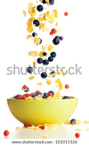 Flying to the bowl corn flakes with berries isolate on white